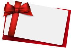White paper card with gift red satin bow. Stock Images