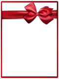 White paper card with gift red satin bow. Stock Photo