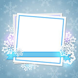 White paper card and snowflakes. On a blue background. Christmas background Stock Images