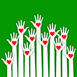 White paper caring up hands hearts vector on green background.  Stock Images