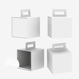 White paper carton box with handle, clipping path included Royalty Free Stock Photo