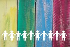 White paper children silhouette on wooden coloured background.  royalty free stock photo