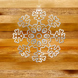 White paper christmas snowflake on a wood. + EPS8. White paper christmas snowflake on a wood background. + EPS8 vector file Vector Illustration