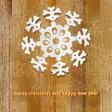 White paper christmas snowflake on a wood.  + EPS8. White paper christmas snowflake on a wood background.  + EPS8 vector file Stock Illustration
