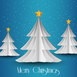 White paper Christmas tree on blue glittering background Stock Image