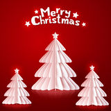 White paper Christmas trees on red background Royalty Free Stock Photos
