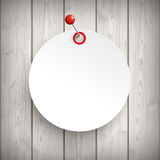 White Paper Circle Sticker Pin Wood. White paper circle sticker with red pin on the wooden background Stock Photos