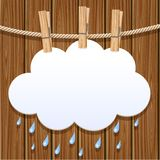 White paper cloud on a clothesline. White paper cloud hanging by clothes peg on a clothesline Stock Photography