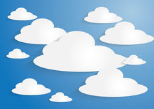White paper clouds on blue sky background Stock Photos