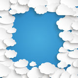 White Paper Clouds Blue Sky Centre. Paper clouds on the blue background Stock Images