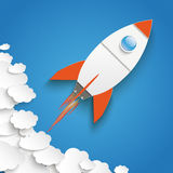 White Paper Clouds Blue Sky Rocket Growth. Paper clouds with rocket on the blue background Royalty Free Stock Images