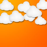 White paper clouds over gradient blue background. Illustration of bunch of white paper clouds over orange background Stock Image