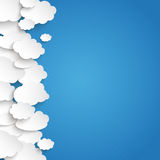 White Paper Clouds Side. Paper clouds on the blue background Stock Photography