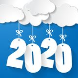 White Paper Clouds With Numbers 2020 Of Coming Year Hanging On Strings With Bows On Blue Background Royalty Free Stock Photography