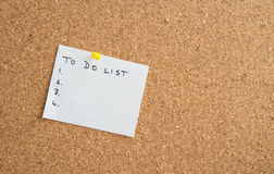 White paper on a cork board Royalty Free Stock Photo