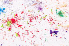 White paper covered in colored pencils sharpening leftovers Stock Photography