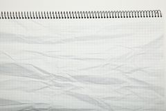 White paper crumpled texture in a cage, abstract. Notepad background royalty free stock photography