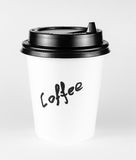White paper cup of coffee with label. On white background Royalty Free Stock Photos