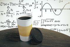 White paper cup of coffee to go with equation on the wall. Mock up Stock Photo