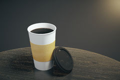 White paper cup of coffee on the wooden table. Mock up Royalty Free Stock Images