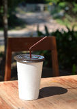 White paper cup with drinking straw. stock photography