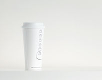 White Paper Cup. Over the white background Royalty Free Stock Images