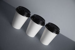 White paper cups isolated on gray mockup set Royalty Free Stock Image