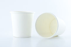 White paper cups on white background Stock Photos