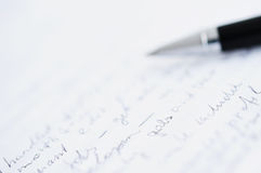 White paper with custom text and blurred ball pen Stock Image