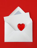 White paper envelope with card and heart Royalty Free Stock Photo