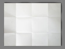 White paper folded and wrinkled on gray background Stock Photography