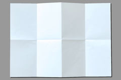 White paper with folds. Isolated on gray background royalty free stock photography