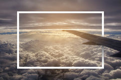 White paper frame with airplane wing. Royalty Free Stock Image