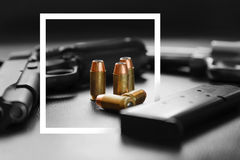 White paper frame with .45 Caliber hollow point bullets Stock Image