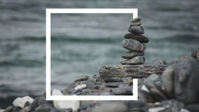 White paper frame with Stones stacked. Royalty Free Stock Photo