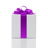 White paper gift box with purple ribbon bow Stock Photos