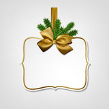 White paper gift card with golden satin bow. Royalty Free Stock Images