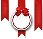 White paper gift card with red satin bow. Royalty Free Stock Photography
