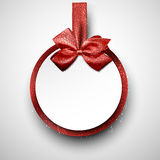 White paper gift card with red satin bow. Royalty Free Stock Images