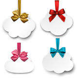 White paper gift cards with color satin bows. Stock Photos