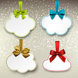 White paper gift cards with color satin bows. Holiday cloud gift cards with color ribbons and satin bows. Vector illustration Royalty Free Stock Photography
