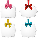 White paper gift cards with color satin bows. Holiday gift cards with color ribbons and satin bows. Vector illustration Royalty Free Stock Image