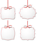 White paper gift cards with red satin bows. Royalty Free Stock Photos