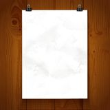 White paper hanging on binder on background texture wood Royalty Free Stock Images
