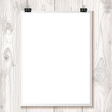 White paper hanging on binder on a background texture wood Royalty Free Stock Photography