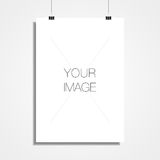 A3/A4 white paper hanging in front off wall for your content Royalty Free Stock Image