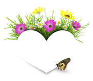 White paper heart with flowers, grass and copy-space Royalty Free Stock Photos