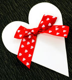 White paper heart with red ribbon bow Royalty Free Stock Images