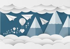 White paper heart shape and balloon in the sky with mountain and cloud. Paper art idea Stock Images