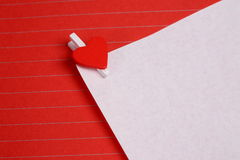 White paper with heart shape clip Royalty Free Stock Photography